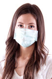 Young woman in medical mask. On white background Stock Photos