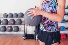 Young woman with medicine ball Stock Photo