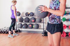 Young woman with medicine ball Royalty Free Stock Images