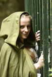 Young woman in medieval attire. In forest Stock Image