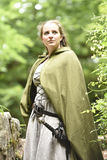 Young woman in medieval attire. In forest Royalty Free Stock Photography