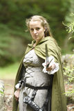 Young woman in medieval attire. In forest Royalty Free Stock Photo