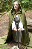 Young woman in medieval attire. In forest Stock Photo