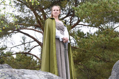 Young woman in medieval attire. In forest Royalty Free Stock Images