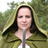 Young woman in medieval attire. In forest Royalty Free Stock Photos