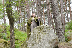Young woman in medieval attire. In forest Stock Photos