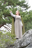 Young woman in medieval attire. In forest Stock Photography