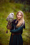 young woman in medieval dress with an owl on her arm Stock Image