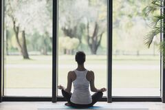 Free Young Woman Meditate At Home, Girl Practicing Yoga Near Floor Window In Yoga Studio, Relaxation, Body Care Concept Royalty Free Stock Photography - 177316367