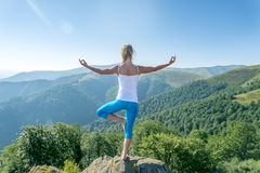 Young woman meditate Stock Images