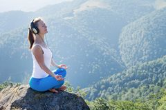 Young woman meditate on the top of mountain Royalty Free Stock Photos