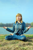 The young woman meditates. Royalty Free Stock Image