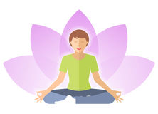 Young woman meditates in the lotus pose with lotus flower. Stock Photos