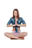 Young woman meditates over white background Stock Photo