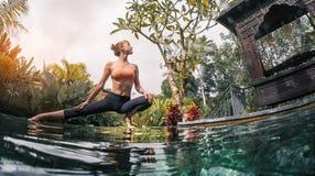 Young woman meditates stock image