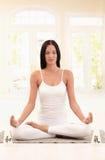 Young woman meditating Stock Image
