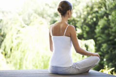 A young woman meditating Stock Image
