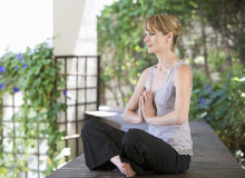 A young woman meditating Stock Photography