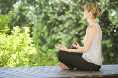 A young woman meditating Royalty Free Stock Photography