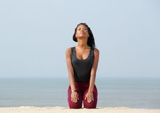 Young woman meditating at the beach Royalty Free Stock Images