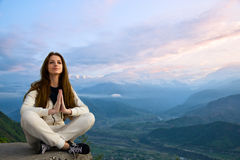 Young woman meditating Royalty Free Stock Photos