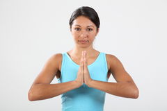 Young woman meditating during exercise routine Royalty Free Stock Photo