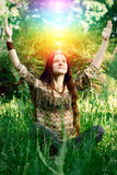 Young woman meditating in the garden Royalty Free Stock Photography