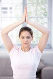 Young woman meditating at home Stock Image