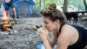 Young woman meditating with Kali mudra hands yoga pose while camping in the forest. Young woman meditating with Kali mudra hands yoga pose stock photo