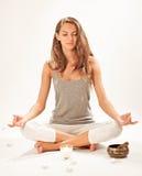 Young woman meditating in lotus pose Stock Image