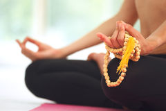 Young woman meditating in lotus pose. Royalty Free Stock Photography