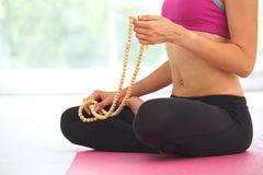 Young woman meditating in lotus pose. Royalty Free Stock Photo