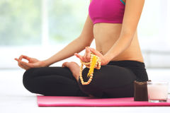 Young woman meditating in lotus pose. Stock Photos