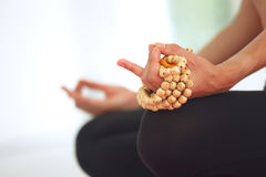 Young woman meditating in lotus pose. Royalty Free Stock Images
