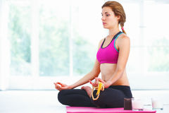 Young woman meditating in lotus pose. Stock Images