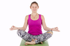 Young woman meditating. In Lotus Pose. Isolated on white background Stock Images