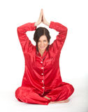 Young woman meditating in lotus position Stock Photography