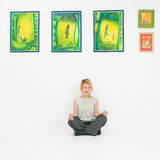 Young woman meditating in lotus position in museum Royalty Free Stock Photo
