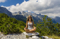 Young woman meditating in the mountains Royalty Free Stock Photo
