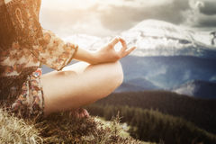 Young woman meditating in the mountains Royalty Free Stock Photos