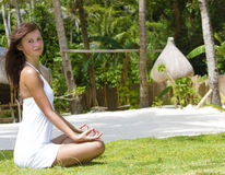 Young woman meditating on nature Stock Photography