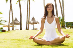 Young woman meditating on nature Royalty Free Stock Images