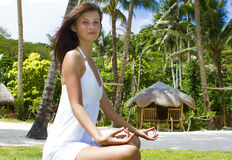 Young woman meditating on nature Royalty Free Stock Image