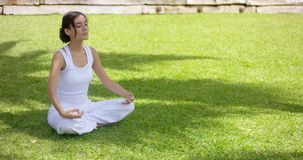 Young woman meditating in nature stock footage