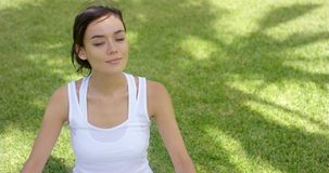 Young woman meditating in nature stock video footage