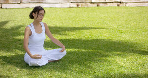 Young woman meditating in nature Royalty Free Stock Image