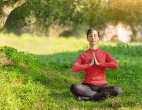 Young woman meditating outdoors Stock Photography