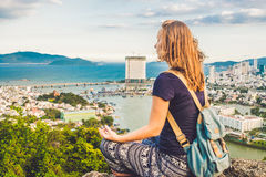 Young woman meditating over ancient city landscape on sunrise Copy space Royalty Free Stock Images