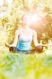Young woman meditating Royalty Free Stock Photos