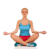 Young woman meditating in pose of lotus Stock Image